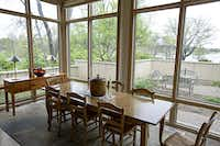 A table overlooks White Rock Lake in Bradfield's home, which was built in 1997 and designed by architect Frank Welch.( G.J. McCarthy  -  Staff Photographer )
