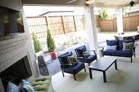 The patio of the model home creates an outdoor living room of sorts. Felder also prides itself on green efforts.(Rose Baca - Staff Photographer)