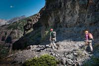 Climber Dianne Leeth follows guide Joe Eppler on the easy start of the Telluride Via Ferrata.  The trailside drops begin to get serious a few hundred yards ahead.