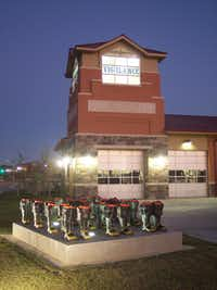 McGehearty won national recognition in 2007 with his United We Stand, an installation of firemen s boots outside Fire Station No. 8 in Fort Worth.(Eric McGehearty)