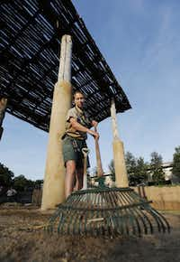 Elephant Keeper Bobbi Wessels rakes a load of hay and elephant droppings into a pile during the morning elephant enclosure cleaning at the Dallas Zoo Monday, August 5, 2013.