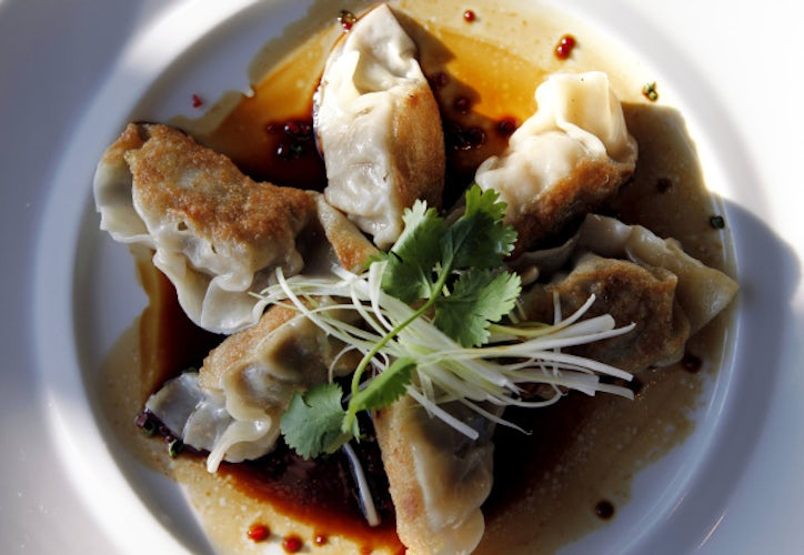 Pork belly pot stickers in a black vinegar sauce flecked with Fresno ...