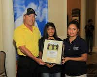 Mark Dailey of Flowserve with two Irving ISD students.( Photo courtesy Communities in Schools Dallas Region )