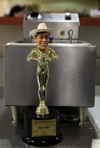 The trophy for best taste sat next to a fryer during the Big Tex Choice Awards on Monday at Fair Park in Dallas. Isaac Rousso was awarded best taste with his Deep Fried Cuban Rolls.