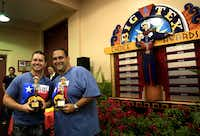 Justin Martinez (left), who won most creative, stands with Isaac Rousso during the Big Tex Choice Awards on Monday at Fair Park in Dallas. Rousso was awarded best taste with his Deep Fried Cuban Rolls.