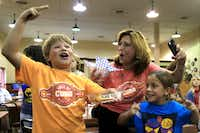 Joseph Rousso, 6, (left) son of Isaac Rousso; Sara Rousso (center), Isaac's sister; and Sara Rousso 6, Isaac's daughter, celebrate after Isaac wins best taste at the Big Tex Choice Awards with his Deep Fried Cuban Rolls on Monday at Fair Park in Dallas.