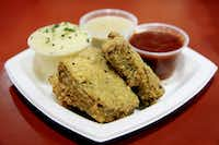 Southern Style Chicken-Fried Meatloaf was among the lineup of fried concoctions at the Big Tex Choice Awards on Monday at Fair Park in Dallas.  Isaac Rousso was awarded best taste with his Deep Fried Cuban Rolls.