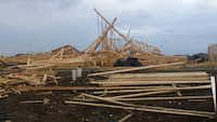 High winds in Frisco collapsed the frame of a house under construction in the Saddlebrook neighborhood. One worker was hurt, but his injuries weren't life-threatening.(Cindy Sampson)