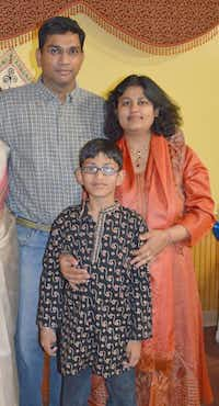 Pallavi Dhawan, shown with son Arnav and husband Sumeet, was accused in the 10-year-old's death. Witnesses were recently called for grand jury testimony.none - David Finn