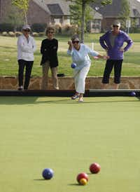 Char Mattison throws her ball during bocce practice at Frisco Lakes. Waiting their turn are Leslie Gardner (left), Sylvia Dodson and Dee Dee Williams.
