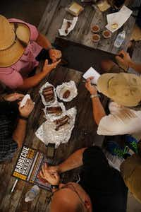 At Brooks' Place in Cypress, the Texas BBQ Posse samples some of the smoked meats.( Tom Fox  -  Staff Photographer )