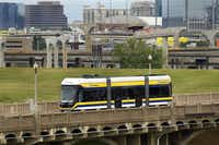 The streetcar is powered by two 550-volt batteries as it crosses the Trinity River on the Houston Street viaduct. Overhead electrical lines power it the rest of the way.(Tom Fox - Staff Photographer)