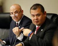 Fort Worth Superintendent Kent Scribner (left) and president Cinto Ramos, Jr. lead the open meeting as hundreds turn out to speak out on the district's transgender policy in schools (Tom Fox/The Dallas Morning News)