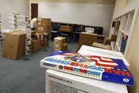 A board game sits atop unpacked boxes of items for use in a classroom at the George W. Bush Presidential Center.