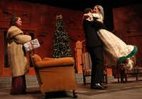 Kaycee Reininger as Aggie Wheeler, left, watches as Christian Genco as Simon Bright, center, lifts, Allyn Carrell  as Martha Gillette during the Ken Ludwig's The Game's Afoot, or Holmes for the Holidays performance on December 12, 2013 at WaterTower Theatre in Addison.