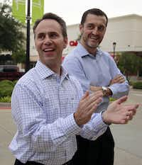 At the opening of the Cedar Hill store, Steve Bain (left), founder and president of Simply Mac, and GameStop CEO Paul Raines cheer.