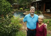 Rob and Suzy Renz pose for a portrait in their backyard garden at their home in Dallas on Friday, October 11, 2013. The Renz's home is one gardens on tour for the annual Dallas County Master Gardeners tour.