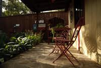 Seating in front of the shed in the backyard of Suzy and Rob Renz's home in Dallas on Friday, October 11, 2013.