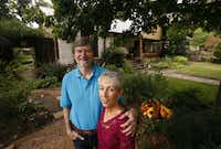 Rob and Suzy Renz pose for a portrait in their front yard garden at their home in Dallas on Friday, October 11, 2013.