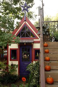 View of the shed and staircase to the home office in the backyard of Suzy and Rob Renz's home in Dallas on Friday, October 11, 2013.