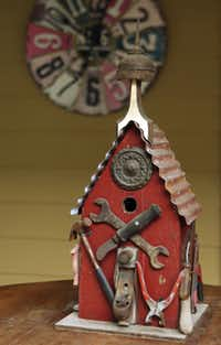 One of the many birdhouses in the backyard of Suzy and Rob Renz's home in Dallas on Friday, October 11, 2013.