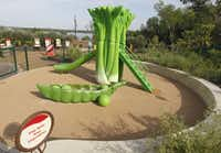 """""""Play With Your Vegetables"""" is the motto in the """"Incredible Edible Garden"""" play area at the new Rory Meyers Children's Adventure Garden at the Dallas Arboretum."""