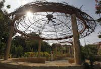 """A ceiling fan hangs in the center of an arbor in the """"Tangled Terrain"""" area at the Rory Meyers Children's Adventure Garden at the Dallas Arboretum."""