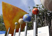 This interactive solar system display is part of the new Rory Meyers Children's Adventure Garden at the Dallas Arboretum.