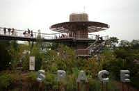 An observation tower connecting to the Texas Skywalk elevated pathway overlooks a section of the Dallas Arboretum's new Rory Meyers Children's Adventure Garden.