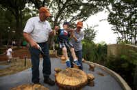 Tyler Kepley, 2 1/2, gets a little help jumping along the Mushroom Patch from grandparents Terry and Melanie Kepley in the First Adventure area of the Dallas Arboretum's new Rory Meyers Children's Adventure Garden.