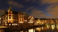 The Speicherstadt (Bonded Warehouse District) in Hamburg, northern Germany, is illuminated one evening.