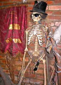 An altar representation of Ghede, the spirit that deals with zombies, at the Voodoo Museum in New Orleans wears a top hat.