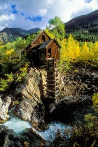 The remains of what's now known as the Crystal Mill stand above a cascading waterfall in the ghost town of Crystal. The often-photographed site may be the most iconic ghost-town structure in Colorado.