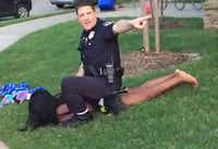 In a widely circulated June YouTube video, Eric Casebolt, then a McKinney police officer, warns others to stay away as he kneels on a teen and handcuffs her after throwing her to the ground at a Craig Ranch pool party. He resigned, and the case is under investigation. (YouTube)
