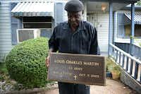Louis Kenneybrew III of Oak Cliff holds the grave marker of U.S. Army veteran Louis Charles Martin he found in a pile of trash on the side of the road near Garrison Street and East Kiest Boulevard. Kenneybrew's friend, Linda Hardeman-Hodo, and Commander Larry Taylor of Jackson-Hughes-Jimison American Legion Post 368 in Richardson worked together to return the lost grave marker to the burial site, which they eventually located at the Lincoln Memorial Cemetery in South Dallas.( ROSE BACA/neighborsgo staff photographer )