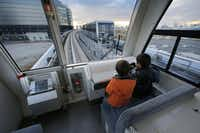 Children ride on Tokyo's Yurikamome Line, which runs without a driver. A spokesman says the automated rail systems reduce the number of workers needed.