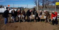 Frisco Gun Club CEO Christian Putnam (center, with glasses), Mayor Maher Maso (center right) and City Council members took part in the club's groundbreaking Friday.