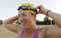Lisa Vega adjusted her goggles before a recent morning swim at Joe Pool Lake in preparation for a triathlon next month.