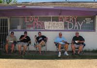 The Texas BBQ Posse sets up camp in the shade next to Fargo's Pit BBQ in Bryan. Left to right, Chris Wilkins, Gary Jacobson, Phil Lamb, Tom Rossman and Jim Rossman.