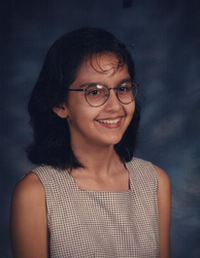 The one with the bangs is when I was trying to fit in during middle school. I burned my forehead so many times attempting to master the bangs. I'm not sure why I'm smiling with this hair color. Now, I'm just me.