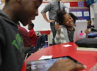 Braxton Brown (left) and Zaria Peace checked out the fourth grade's new iPads at Rutherford Elementary in Mesquite.