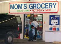 Personnel from the Dallas County medical examiner's office removed the body of Waqar Hasan from the Pleasant Grove convenience store he operated on Sept. 15, 2001.