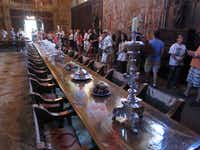 Visitors tour the dining room of newspaper publisher William Randolph Hearst's 165-room estate.
