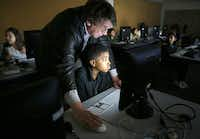 Fifth-grader Tyler Anderson receives help from Dean Baird in designing a web page at St. Mark's School of Texas.