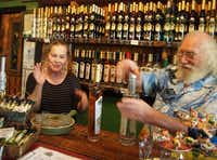 Michael and Alla Ward serve up a concoction of liqueurs and schnapps to sample at Tamborine Mountain Distillery, North Tamborine, Australia. Michael creates elaborate, handcrafted spirits in handmade copper stills from the area's abundant native fruit. Much is grown on the family's orchards, enriched by volcanic soil and spring water.