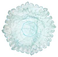 Her serve: An azure platter in a sunflower shape is hand blown and features distinctive variations in color. No two are exactly alike. The platter is 15 inches or 20 inches in diameter. $49 and $55 at Culinary Connection, Plano.