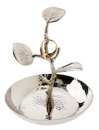 Put a ring on it: An olive branch ring holder by noted tabletop designer Michael Aram has a gold-plated branch rooted in a stainless-steel dish. It's 5 inches by 3.5 inches; $60 at Culinary Connection in Plano.