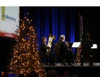 The Dallas Symphony Orchestra Brass Quintet performed at the luncheon for 500 homeless people at the Omni Dallas Hotel on Monday.