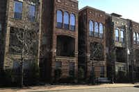 The facade of City View at Farmers Market town homes reflects the sunlight in the Dallas Farmers Market district. The leaders of neighborhood groups representing Deep Ellum, Farmers Market and The Cedars on downtown's southeast side are forming a coalition to trade ideas and increase their effectiveness at City Hall.
