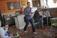 Peter Donkin walks away from the counter at Murray Street Coffee Shop in Deep Ellum after ordering a coffee.
